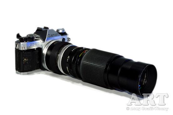 Abbildung eines Fotoapparates mit aufgestockten Objektiven
